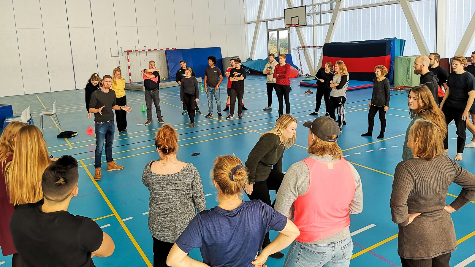 Group of young people learn movement in a gymnasium